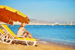 Girl relaxing on a beach chair near the sea Stock Photography