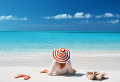 Girl relaxing on the beach Royalty Free Stock Image