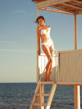 Girl relaxing in a beach gazebo Royalty Free Stock Images