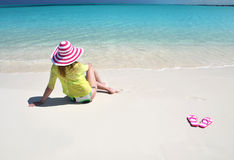 Girl relaxing on the beach stock image