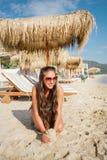 Girl relaxing on the beach Stock Photos
