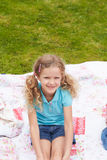 Girl Relaxing On Blanket During Camping Holiday Royalty Free Stock Image