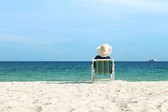 Girl relaxing at chair beach Stock Images