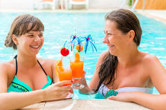 Girl relaxing with cocktails Stock Photos