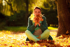 Girl relaxing in colorful forest foliage outdoor. Royalty Free Stock Images