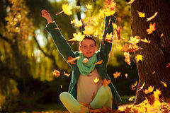 Girl relaxing in colorful forest foliage outdoor. Stock Photography