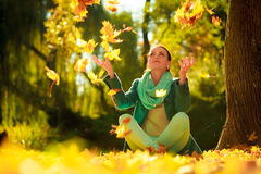 Girl relaxing in colorful forest foliage outdoor. Royalty Free Stock Photos