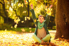 Girl relaxing in colorful forest foliage outdoor. Stock Images