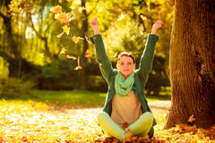 Girl relaxing in colorful forest foliage outdoor. Royalty Free Stock Photography