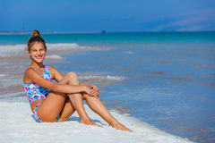 Girl relaxing at the Dead Sea Stock Photo