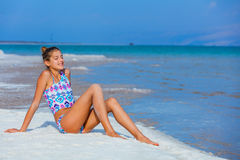 Girl relaxing at the Dead Sea Royalty Free Stock Photography