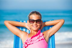 Girl relaxing on deck chair Royalty Free Stock Photography