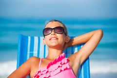 Girl relaxing on deck chair Stock Image