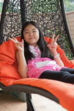 Girl relaxing emotion on hanging bed at home terrace Royalty Free Stock Photography