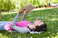 Girl relaxing and enjoying on grass Royalty Free Stock Photos