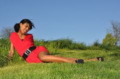 Girl relaxing in a field Royalty Free Stock Photo