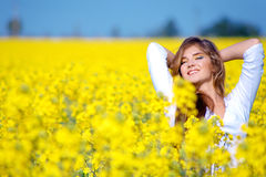 Girl relaxing in field of flowers Stock Photo