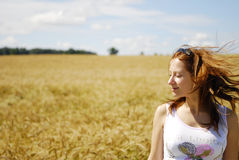 Girl relaxing in fields Stock Images