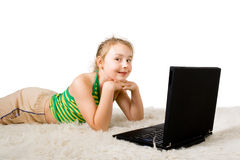 A girl relaxing on the floor. With a laptop Stock Image
