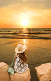 Girl relaxing on the golden beach. Stock Photography