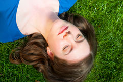 Girl relaxing in the grass Royalty Free Stock Image
