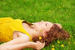 Girl relaxing on the grass. And looking up Royalty Free Stock Image
