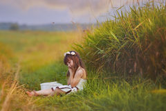 Girl relaxing in grass. Little girl relaxing in grass