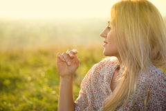 Girl is relaxing on green field Stock Photo