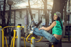 Girl relaxing on gym cycling machine Royalty Free Stock Images
