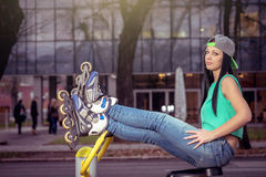 Girl relaxing on gym cycling machine Royalty Free Stock Photos