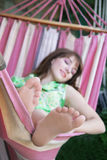 Girl relaxing in hammock Stock Photos