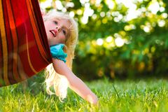 Girl relaxing in a hammock stock photo