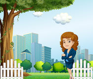 A girl relaxing on her breaktime near the tree Royalty Free Stock Photography