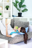 Girl relaxing at home stock images