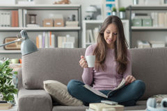 Girl relaxing at home Royalty Free Stock Images