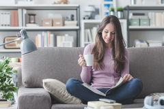Girl relaxing at home Royalty Free Stock Image