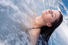 Girl relaxing in Jacuzzi. Young girl relaxing in Jacuzzi stock photography