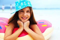 Girl relaxing with lilo on the beach Stock Photography