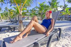 Girl relaxing on the lounge at the beach. Near ocean stock photography