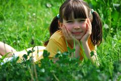 Girl relaxing in meadow Stock Photography
