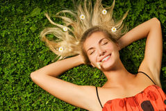 Girl relaxing on a meadow royalty free stock photography