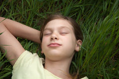 Girl relaxing on a meadow in nature Royalty Free Stock Image