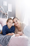 Girl relaxing with mother Stock Photo