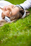 Girl relaxing with music Royalty Free Stock Photos