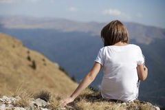 Girl relaxing in nature. White teen touching vegetation from carpathian mountains range Royalty Free Stock Photo