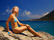 Girl relaxing near the sea Stock Photography
