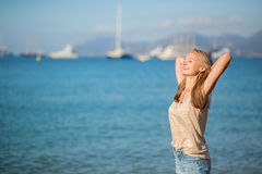 Girl relaxing near the sea, enjoying her vacation Royalty Free Stock Photo