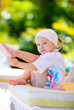 Girl relaxing near swimming pool Royalty Free Stock Image