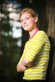Girl relaxing near tree Stock Photography