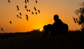 Girl relaxing outdoors at sunset Royalty Free Stock Photography